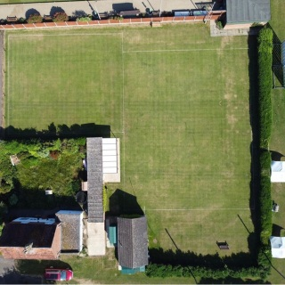 Main 2 lawns and club house with undercover seating area